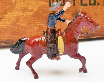 Toy Cowboy  Britains' Ltd London / Authentic Original Copper colored Pistal / Moveable Arm