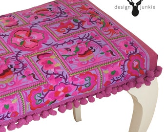 Pom Pom Hmong: restored and reupholstered stool with detailed pink embroidery of the Hmong tribe.