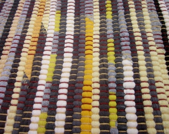 yellow and grey handwoven rag rug made from recycled t-shirts