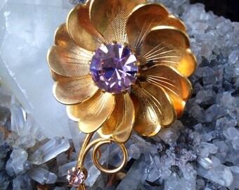 Vintage Metal flower pin with violet rhinestone
