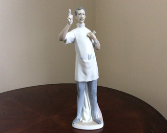 Lladro's Beautiful Porcelain Glossy Figurine, 'The Dentist'.