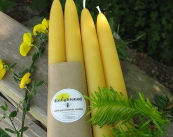 Pure beeswax taper candles. 9 inches tall. 2 tapers per set. Wrapped in recycled kraft paper. Unbleached Cotton wick. 100% pure beeswax.