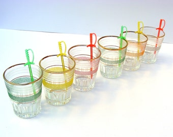 Set of six gilded/colored shot glasses