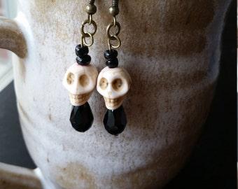 Classy white skull earrings
