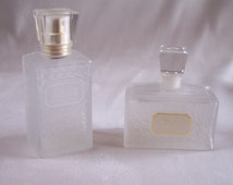 2 empty perfume bottle Miss Dior by Christian Dior eau de toilette and deodorant frosted bottle houndstooth pattern