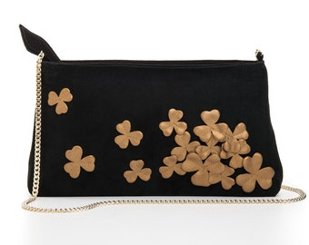 Leather clutch with flowers applique