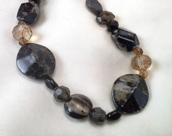 Black and Brown Necklace Featuring Glass Beads