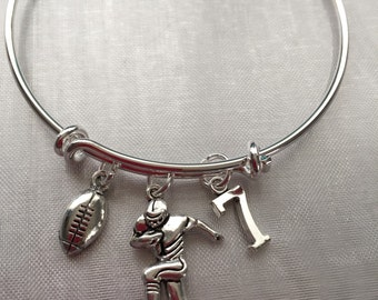 Football bracelet with football player and number