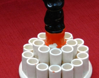 Vintage Ceramic Cigarette Holder Featuring Black Cat on Orange Pedestal Surrounded by 22 Cigarette Holders      00397