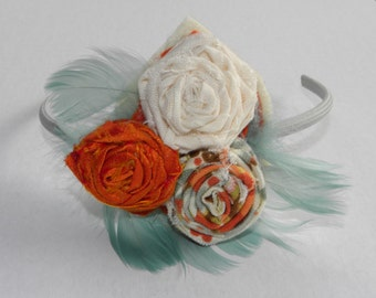 White, Orange, Red, and Teal Fabric Flower Headband with Teal Feathers