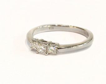 Princess Cut Three Stone Ring set in 18ct White Gold