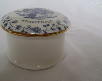 Blue and white china trinket box souvenir - Bolton Abbey Wharfedale - ruined Augustinian monastery. Round with gold rim to lid.