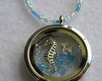 Seahorse Sea horse in a glass fillable pendant with crystal beads on a blue and irredescent beaded necklace with matching earrings