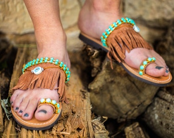Genuine leather sandals with acrylic stones,suede leather fringes &evil eyes