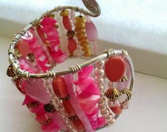 Bright pink beaded wrist cuff