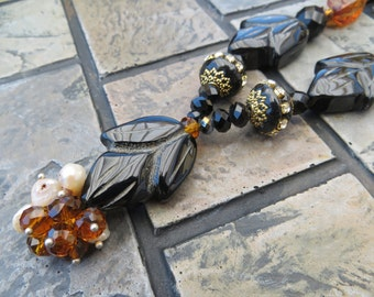 Aida Long Necklace in Earth Tones with Faceted Glass and Carved Beads