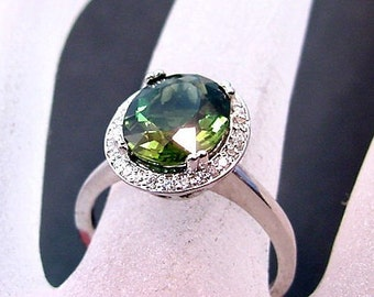 AAA Green Tourmaline   10x8mm  2.54 Carats   in a 14k White gold ring with Halo of diamonds (.18ct) 0612