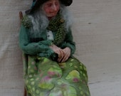 Maggie 12th Scale Miniature Dollshouse Witch Doll Sitting On Chair.