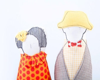 Soft sculpture, Couple dolls Portrait ,Fabric man in Papillon hat and jacket . Woman in orange dotted red collared shirt & yellow skirt TIMO