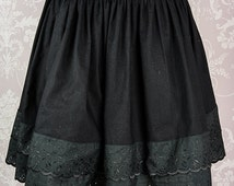 Cotton underskirt with broderie anglais trimming in black, ivory or white.