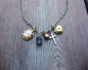 Repurposed charms necklace sterling silver wishbox,cameo,copper bell,sterling cross,brass locket