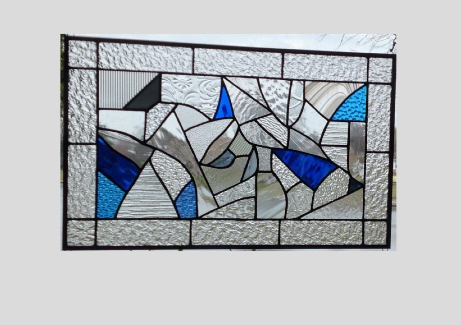 Stained glass panel window geometric abstract blue clear