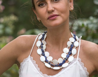 Rich multi strand statement necklace with white porcelain, mother of pearl and denim blue lapis lazuli stones, three strand large fashion