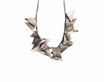 Leather necklace. Dangling necklace, recycled leather effect metal triangles.
