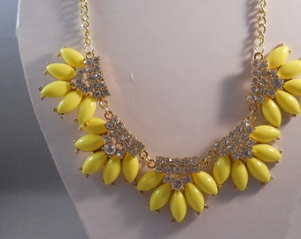 SALE Bib Necklace with Gold Tone, Yellow and Clear Rhinestone Pendants on a Gold Tone Chain.