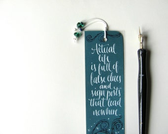 Forster teal bookmark with quote in handwritten calligraphy