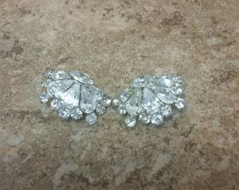 Vintage clip on rhinestone earrings in silver tone metal