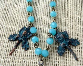 10% off on this item - Ocean blue roundell glass beads with patina iris and ice resin mermaid repurposed assemblage necklace