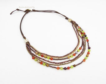 Brown orange green stone necklace with jasper, brass beads, glass beads, gold plated chain on soft brown polyester cord, multistrands