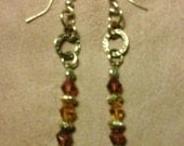 Gold  tone earrings with dark and light topaz big cone glass beads.