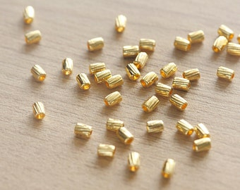 50 pcs of Gold plated Column Tibetan Style Beads - 4 mm