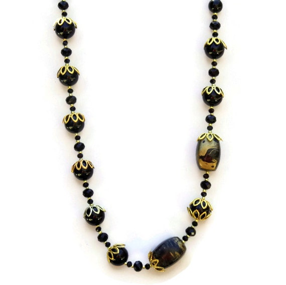 formal asymmetrical black and gold necklace special occasion