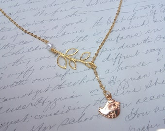Gold bird on branch lariat necklace with pearl