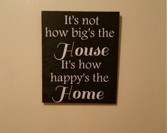 It's not how big's the house wooden sign