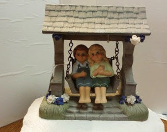 Ceramic Country Boy and Girl on a Garden Swing
