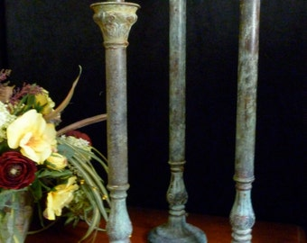 Vintage distressed metal candlesticks from the early 90's.  A set of three in different heights