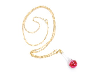 Golden necklace with vintage glass teardrop pendant, transparent and red magenta sparkling, minimalistic accessory 1970s