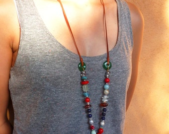 Long colored boho chic necklace with leather and semi precious beads and pearls