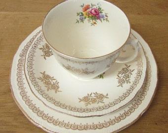 Vintage teacup & saucer set, gold roses with contrast/hidden floral motif