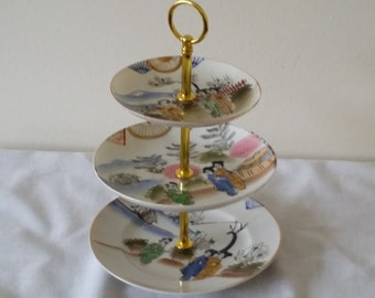 Small Three Tier Cake Stand or Trinket Stand Made With Vintage Japanese Themed Plates And New Gold Coloured Fittings