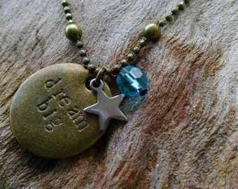 Hand stamped 'dream big' inspirational star and crystal charm necklace in antique bronze