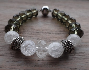 A smoky quartz bracelet with quartz crystal gecrascht and silver beads simply bewitching.