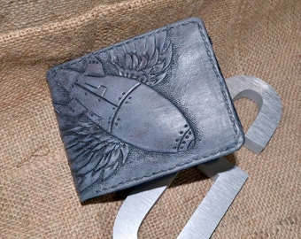 Handmade, hand tooled men's leather wallet with retro flying bomb design