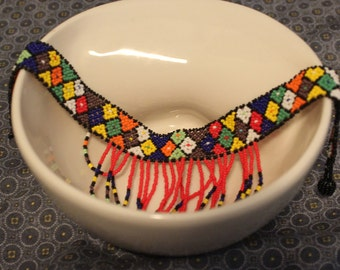 Beaded choker can be used as a head accessory