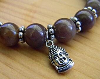 Purple adventurine beads with buddha charm.