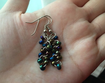 Multi-colored beads and rings dangle earrings